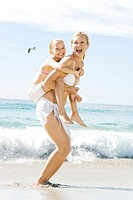 A mother and daughter playing on the beach