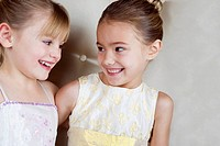 Two little girls wearing party dresses
