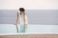 A woman relaxing by a pool (thumbnail)