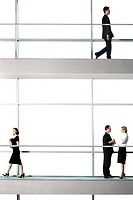 Office workers walking around modern office building (thumbnail)