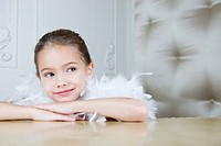 Portrait of a young girl with a feather boa in dressing up clothes