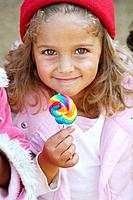 Smiling girl with lollipop