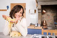 Woman holding pasta dough