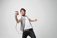 Japanese man listening to mp3 player
