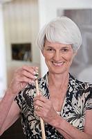 A senior woman holding a snooker cue