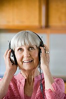 Senior woman wearing headphones