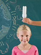 Girl with energy saving lightbulb