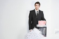 Man shredding paper