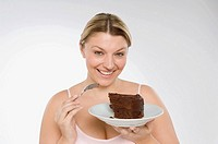 A woman holding a chocolate cake