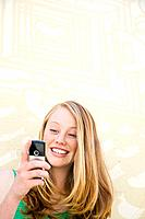 A teenage girl using a cell phone
