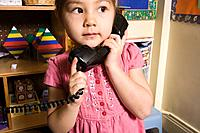 A girl using a telephone