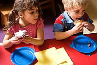 Children eating cakes