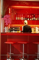 The plush red interior of the cocktail bar at the Millbank Lounge in the City Inn Hotel, Westminster