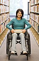 Mixed Race woman in wheelchair at library (thumbnail)