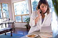 Hispanic woman talking on telephone (thumbnail)