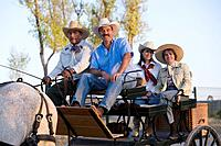 Hispanic family in horse_drawn carriage
