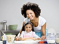African mother and daughter baking