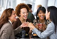 Multi_ethnic businesswomen having coffee