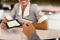 Customer paying bill at diner