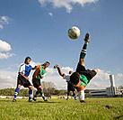 Multi_ethnic men playing soccer