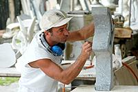 Sculptor working with marble, Carrara, Tuscany, Italy