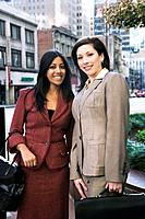 Multi_ethnic businesswomen in urban area