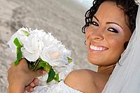 Hispanic bride holding bouquet