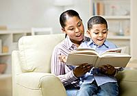 Mixed Race mother and son reading