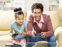 African mother and daughter playing video games