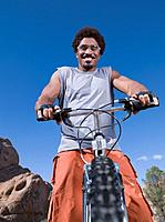 African man on mountain bike