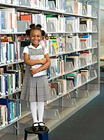 African school girl holding library book