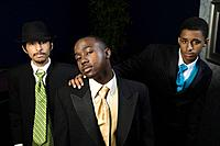 Multi_ethnic men wearing suits
