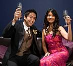 Asian couple toasting with champagne