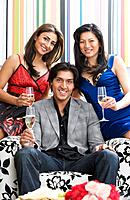 Multi_ethnic friends holding champagne