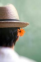 Hispanic man wearing hat with flower