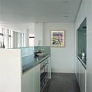 Modern galley kitchen in open plan loft conversion
