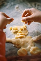 Child making a pastry man