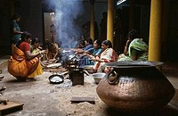 Women frying oil cakes, Chettinad, Tamil Nadu, India