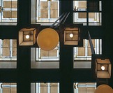 UNITY TEMPLE, OAK PARK, ILLINOIS, USA, FRANK LLOYD WRIGHT, INTERIOR, INTERIOR DETAIL LOOKING UP TO CEILING WITH LAMPS AND GLASS