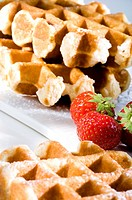 Close_up of waffles and strawberries