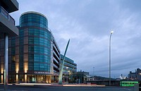 CLARION HOTEL AND CITY QUARTER OFFICES, LAPPS QUAY, CORK, IRELAND, SCOTT TALLON WALKER ARCHITECTS, EXTERIOR, DUSK VIEW SCULPTURE BY EILIS O'CONNELL