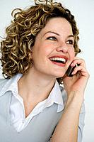 Portrait of smiling woman on mobile phone