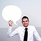 portrait of a businessman holding a word balloon