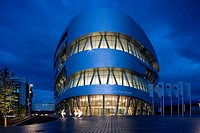 MERCEDES MUSEUM, MERCEDESSTRASSSER 100, STUTTGART, GERMANY, UN STUDIO BEN VAN BERKEL AND CAROLINE BOS, EXTERIOR, TWILIGHT EXTERIOR FROM THE CENTRE FRO...