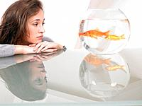 Woman looking at a goldfish