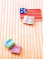 Paper clay toy, flag and book