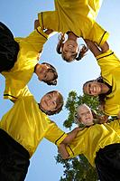 Five children soccer players 7_9 years huddling view from below portrait