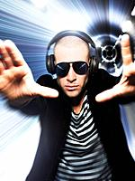 Man wearing headphones in front of tunnel effect view through hands