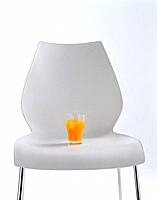 A glass of juice on the chair