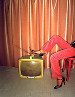 Woman legs on TV